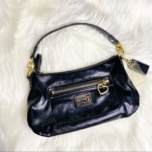 Mini black coach purse with logo on front